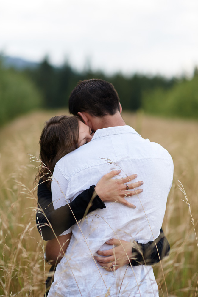 engaged-couple-embracing-in-kamloops-photo-session.jpg