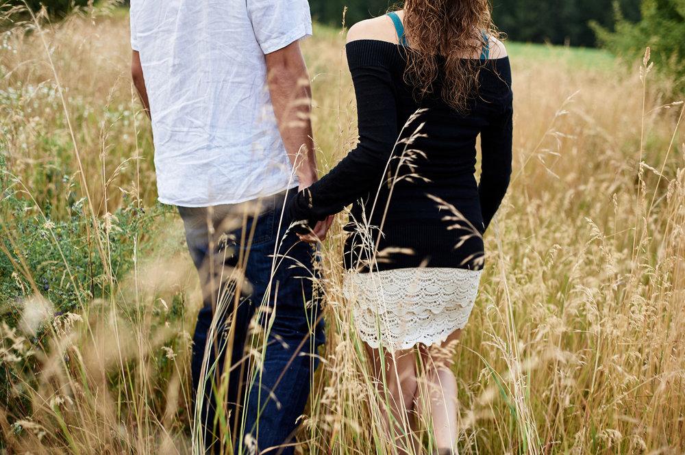 engaged-couple-walking-hand-in-hand-okanagan.jpg