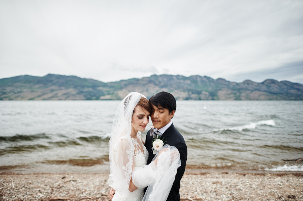 bride and groom wedding portrait by okanagan lake