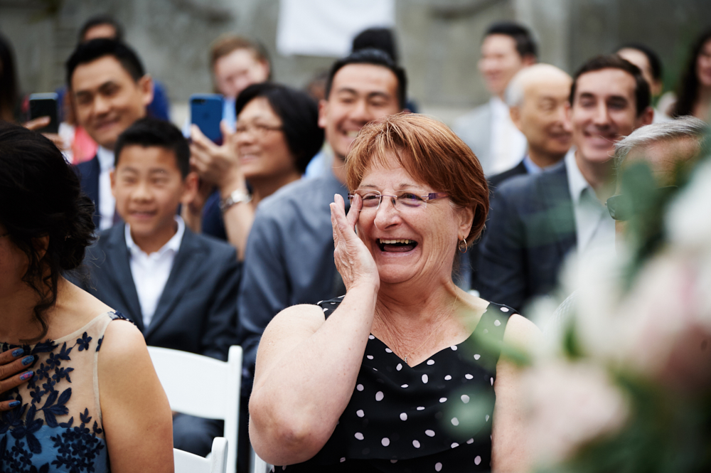 wedding guests laughing at ceremony