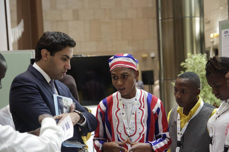 Wantoe Teah Wantoe interacting with Former UN Envoy on Youth Ahmad Alhendawi in 2015.