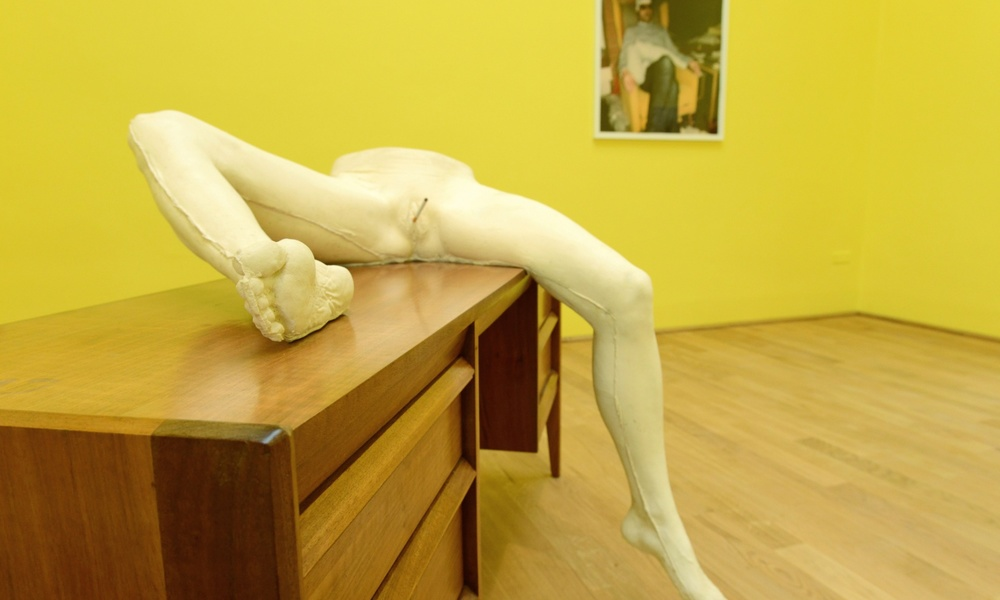 """Sarah Lucas has a message for all her dissenters: """"if you happen to be one of those people who feel the sculptures would have been better without cigarettes. well, I put them there for you too"""", so up yours. Lucas calls the colour of her walls (YBT rep.) at the 2015Venice Biennale'deep cream'whilst Alice Sprawls,the writer of the article I took the quote from, calls them 'marigold yellow.' * Ah dear yellow, so many affects effects, so many readings, and what of the image on the wall behind the cast lower torso of her unnamed friend? * LRB, vol 37, no12, 18 June 2015"""