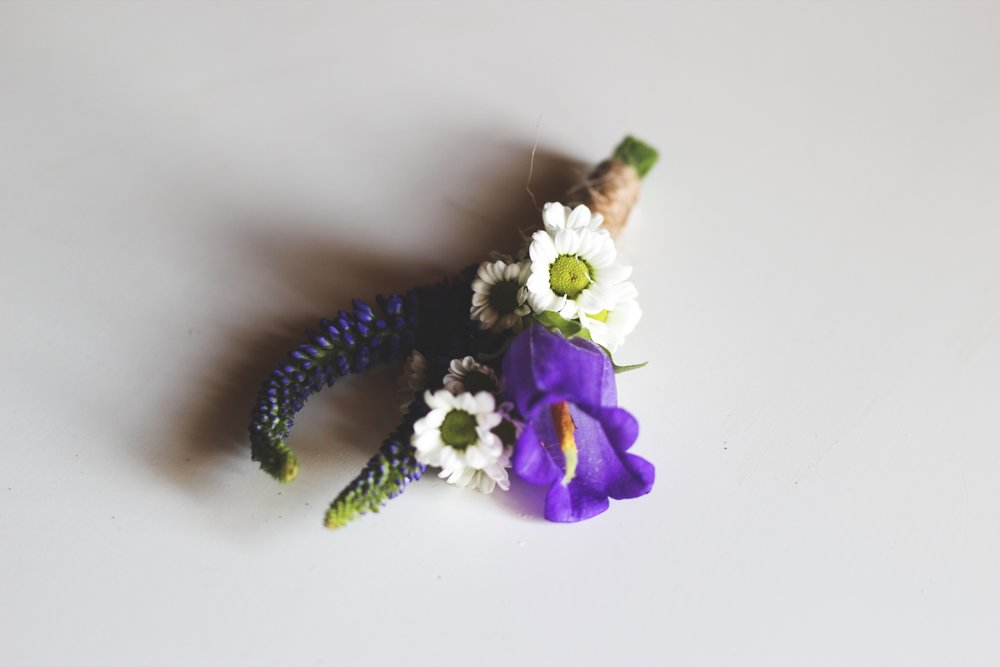 Blue bell flower, white pomms and purple veronica boutonniere wrapped in twine - Roots & Wildflowers