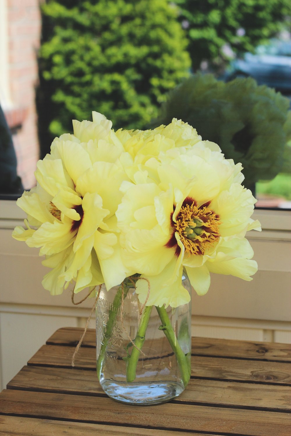 High noon yellow peony mason jar flower arrangement – Roots and Wildflowers