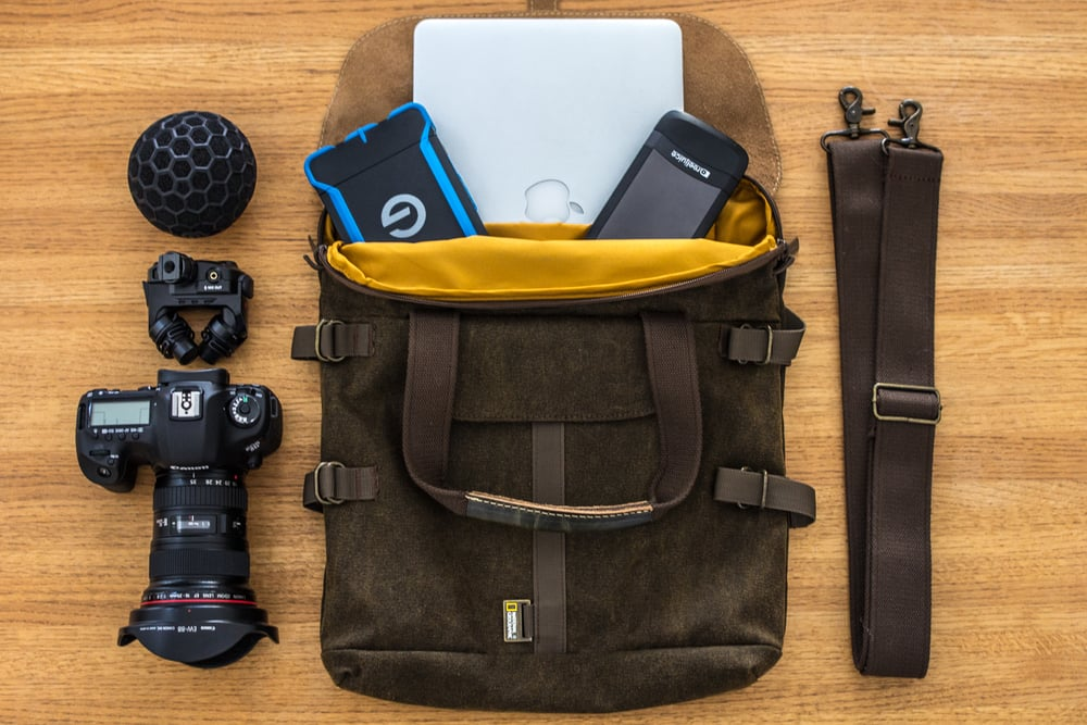 {Pictured: Apple Macbook Pro, G-technology ATC Rugged 1tb drive, Lynktec Reel Juice portable charger, Canon 5dmiii, Rode Stereo Mic X, Nat Geo/ Manfrotto tote bag}