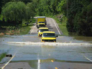 restoration trucks in flood