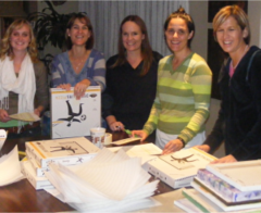 Andrea Mellon, Jen Martin, Lara Mellon, Angela McCall and Dawn Benyi packing boxes.