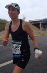 Lisa Collet running the 2014 Comrades marathon in the everyONEcounts kit.