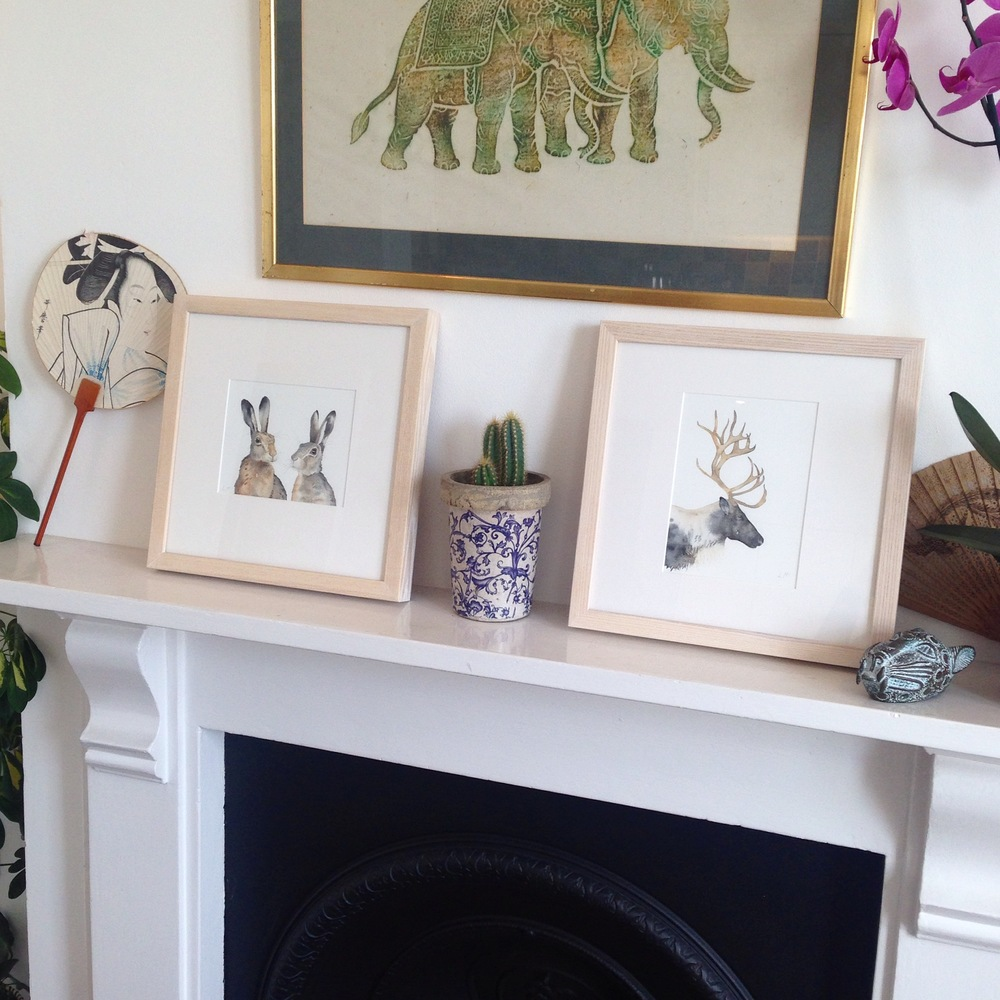Framed original watercolours, 'Pair of Hares' and 'Reindeer'