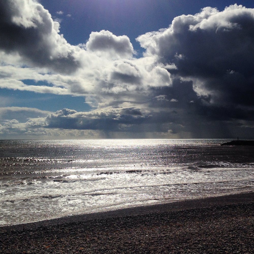 Clouds and coast at Sidmouth by Lindsay McDonagh