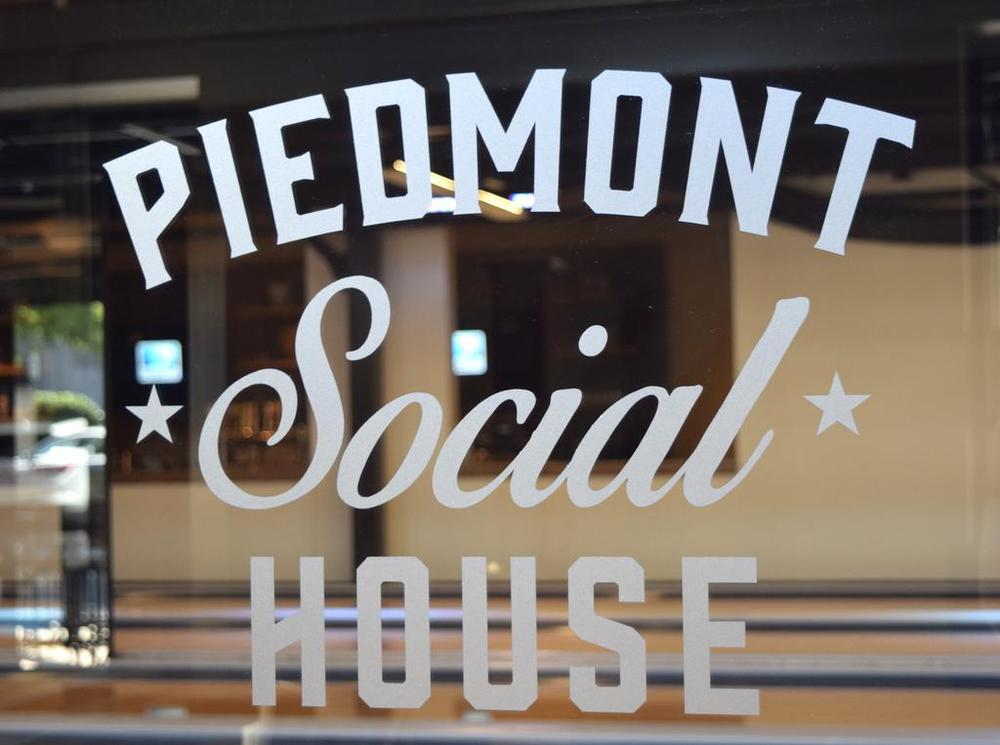 Piedmont Social House   (PSH) provides a wide variety of unique dining, drink, and entertainment options. Between its 21,000 SF of indoor space and 5,000 SF patio, PSH offers a full-service restaurant, two bars, bowling alleys, darts, corn hole, shuffle board, bocce ball, ping pong and billiards tables among others. Patrons can enjoy PSH's signature fried chicken or choose from a number of southern-inspired menu items. PSH's expansive selection of draft brews and signature cocktails perfectly are the perfect complement these delectable meals or a round of bowling.  Located at 2135-C Ayrsley Town Blvd, Charlotte, NC 28273