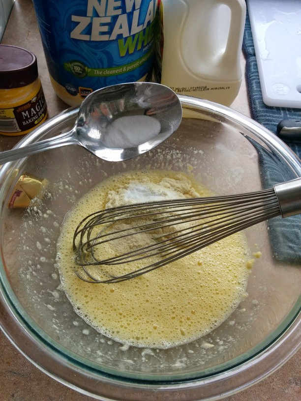 Beat egg and egg white until frothy. Add protein powder. Whisk until smooth. Add coconut flour, mix until smooth and then add leavening agents (baking powder and soda.)