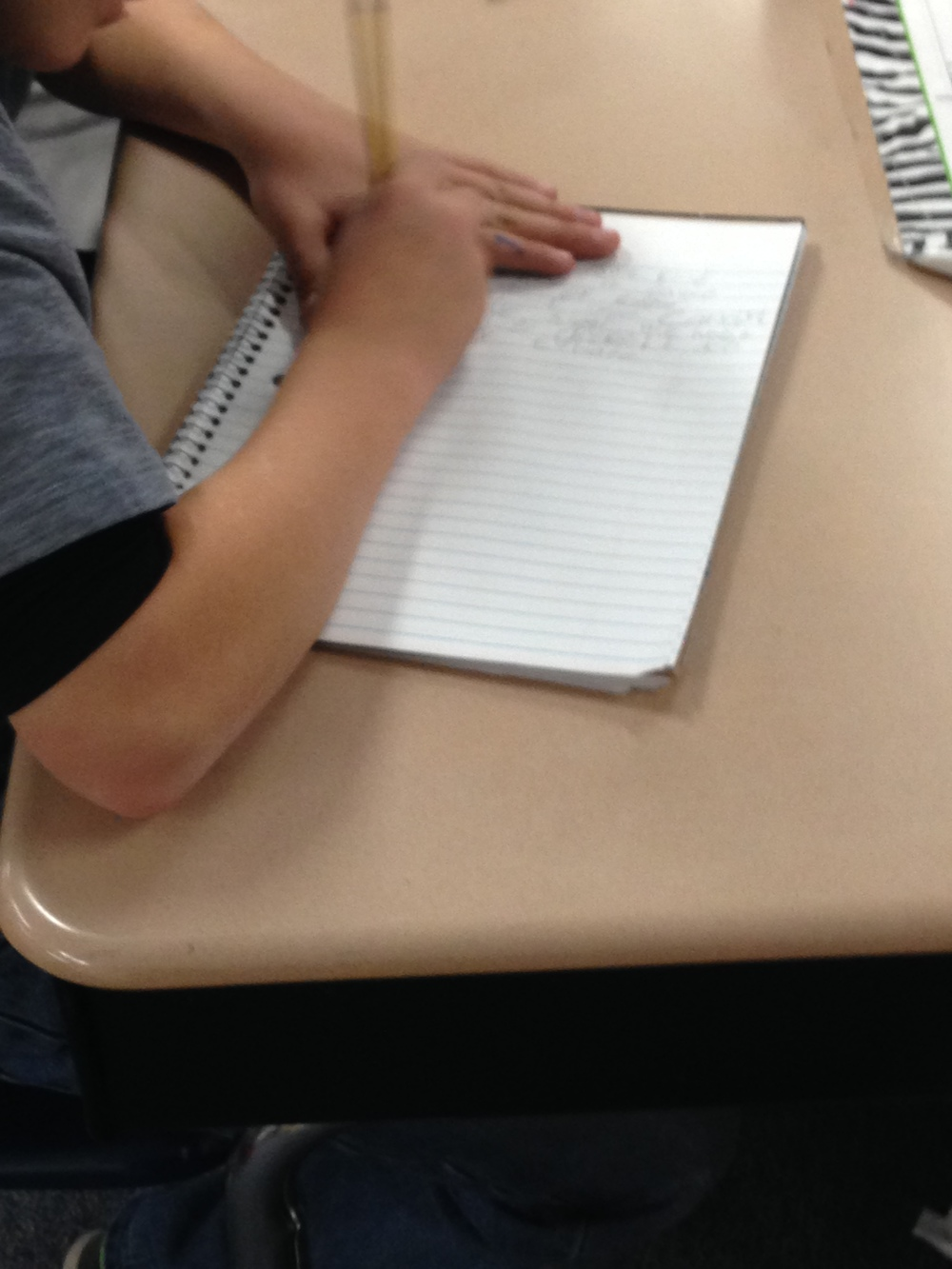 Writing so fast, the pencil is blurry!