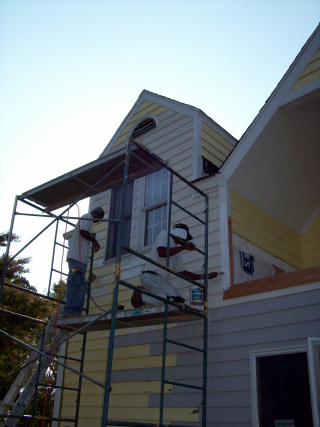 This home had a second floor flat room that had a small hole in it. The resulting damage claimed two large casement windows, all of the exterior siding, insulation and drywall. The entire side of this house was completely repaired and painted.