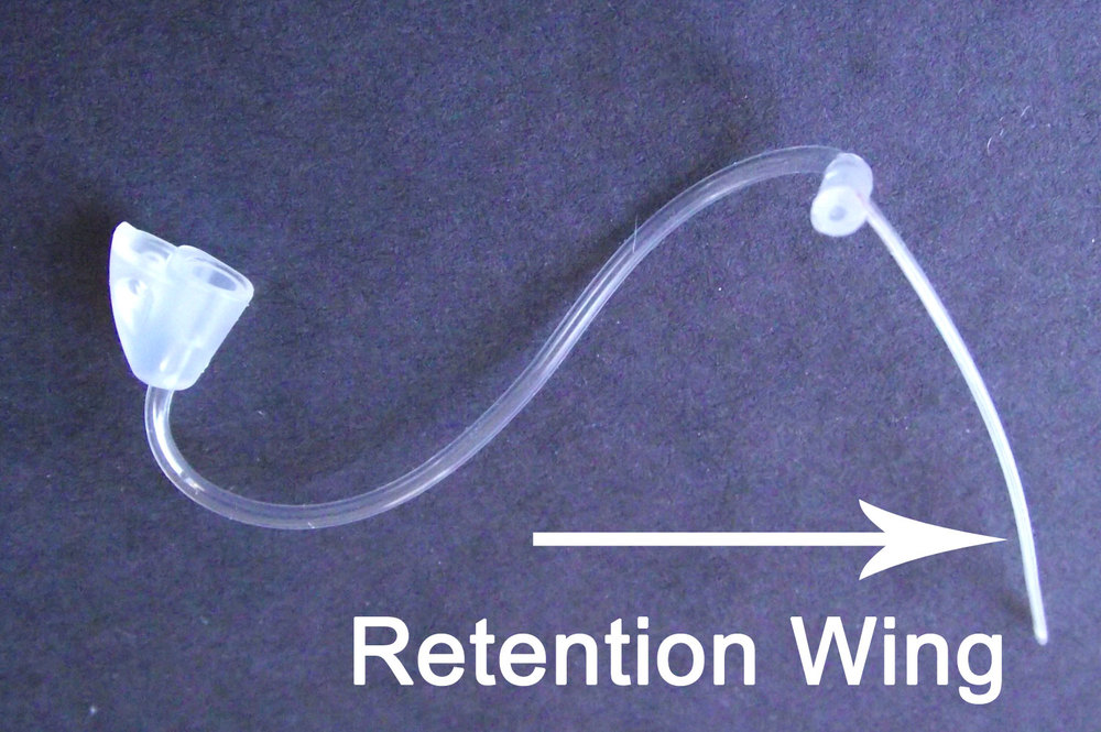 Retention wing on Hearing Aid