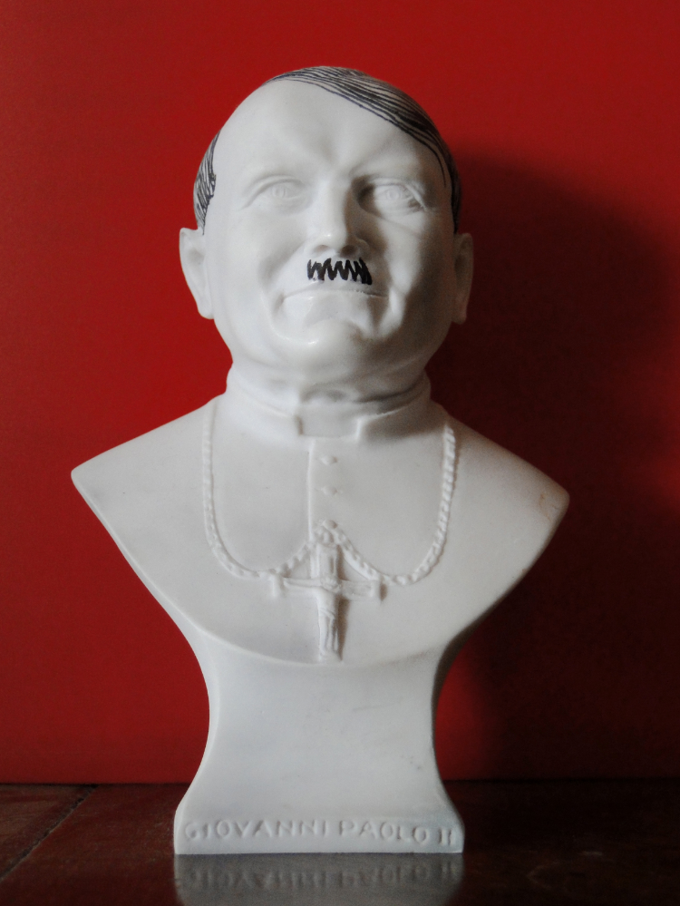 2009 Acrylic pen on resin sculpture Dimensions variable Back from a trip to the Vatican, Sebastian Errazuriz confesses that to avoid boredom on the plane, he brought with him a resin bust of Pope  John Paul II, wich he bought as a souvenir. Although the artist has not expressed the meaning behind tampering with the religious figure, we can only assume it is another exercise in which he addresses his public condemnation of the Catholic Church, which has banned the use of condoms in Africa while the continent battles an AIDS epidemic.