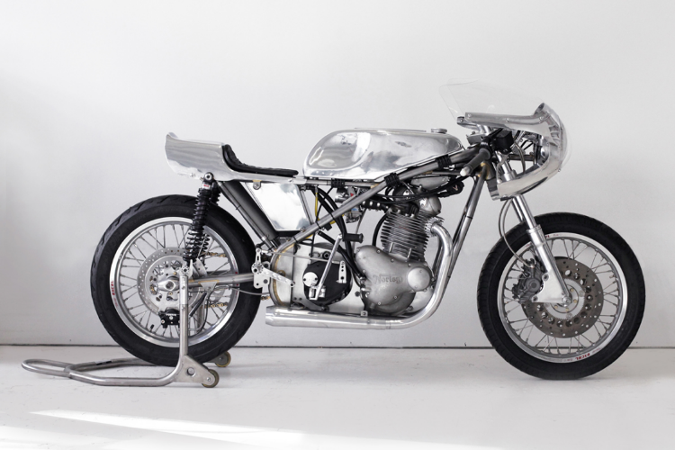 2013  Collaboration with Worth Motorcycle Company and NYC Norton  Norton motorcycle, aluminum, steel and glass with taxidermy  46 x 84 x 16 in (116,8 x 213,4 x 40,6 cm)  The customized speed bike of Sebastian ErraZuriz is a functional racing bike that is also a fetish object stripped down to its sculptural framework. A masculine symbol of power and freedom, the motorcycle also functions on the boundary of fragility and fatality--between the epic tagline living fast and dying young.   ErraZuriz has inserted a taxidermy bird inside a glass vestibule in the motor of the bike, the body which the rider straddles. Under the tank, the bird lays as if in a metal and glass coffin, functioning like the heart of the object, and as a symbol of awareness to nature, death, and fragility of the body. The bird decontextualizes the bike from its function, making death a core element.  The Motorcycle was produced by Worth Motorcycle Company and built by the incredible team at NYC Norton who offered all the technical and constructive support to create Sebastian ErraZuriz's unique design.This project was made possible thanks to the generous support of motorcycle collector John Magyar.  A portion of profits will be donated to Worth Motorcycle Company, a nonprofit organization teaching NYC's at-risk youth the art of vintage motorcycle restoration.