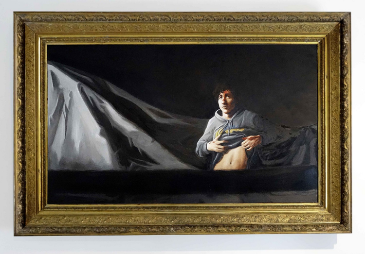 "2013 Oil paint on particle board, Gilded antique frame 54""1⁄2 x 82""1⁄2 x 3""1⁄2  Painters  like Goya, Caravaggio or Rembrandt have historically constructed martyrdom by using aesthetics to manufacture empathy. Sgt Sean Murphy, a photographer for the Massachusetts State Police pictured the alleged Boston bomber Dzhokhar Tsarnaev on April 19, 2013 in a dry-docked boat in Watertown, just outside Boston during his capture by special police forces. On July 18, 2013, Sgt Sean Murphy published the image above in Boston Magazine as a response to the image portrayed of Tsarnaev in The Rolling Stone August issue. Hours before this image was taken, Tsarnaev witnessed the death of his brother. Friends and colleagues of Tsarnaev still do not understand what happened to their neighbor. Dzhokhar Tsarnaev faces a probable death sentence based on large amounts of evidence that allegedly will prove him guilty of an attack that killed three and injured hundreds."