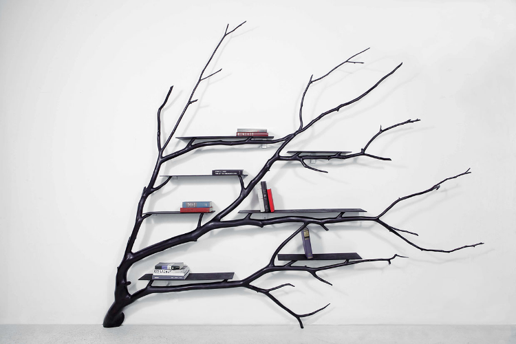 2013 Platano oriental wood, Jequitiba wood, and stainless steel. H:96 x W:120 x D:14-1/2 in  (H:243,8 x 304,8 x 36cm)  Bilbao receives its name from the street in Santiago where the artist found a branch that had broken off a fallen tree. The branch was taken to the workshop and twisted, turned, and readapted so it could hug a flat wall and live a new life as a shelf. The shelf is part of the tree series, which attempts to let the natural forms found in nature dictate the majority of design.