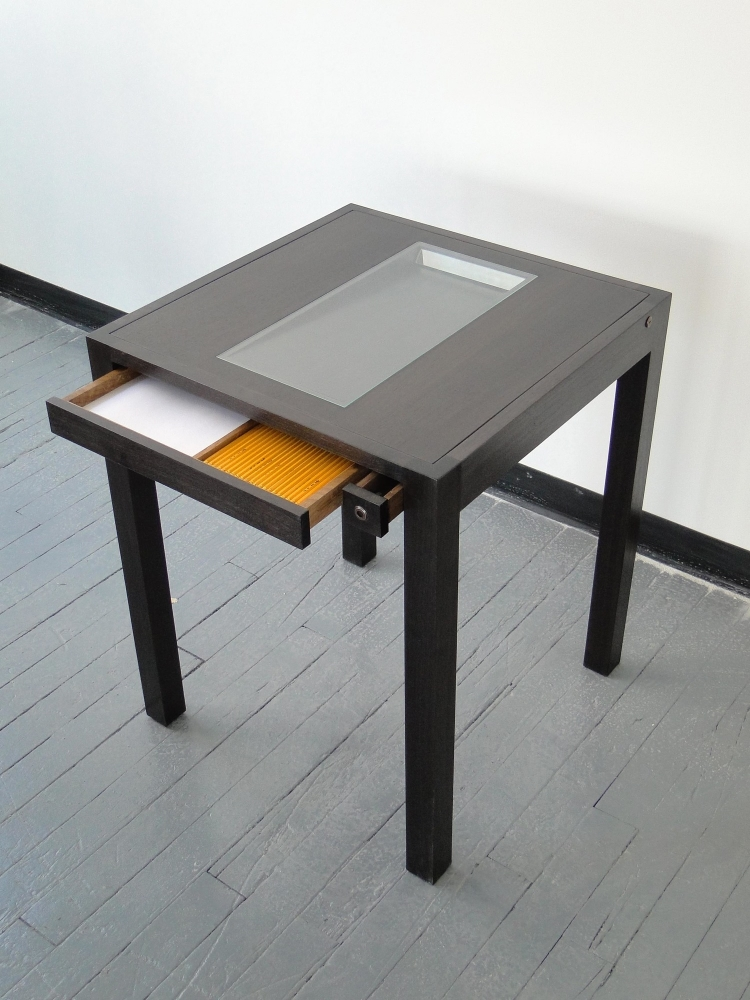2007 Wood, glass and adjustable mirror H:1/2 x W: 24 x D: 24 in  (H:74,9 x W:61 x D:61 cm)  Reflection Desk includes a thin strip of mirror that can be regulated to the user's exact height; thus it always reflects the user's gaze and invites them to be aware of their daily existence.