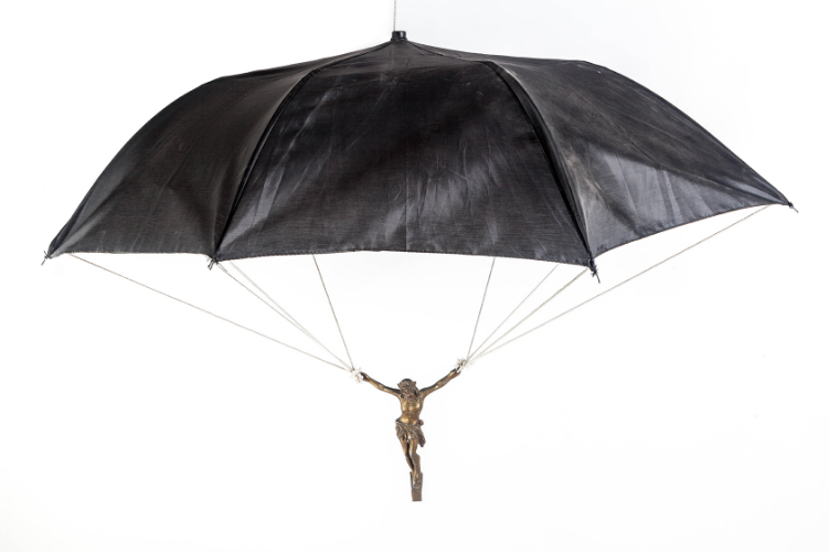 Jesus Paratrooper 2010 Bronze crucifixion, string and umbrella 34 x 36 x 22 in (91.4 x 91,4 x55,9cm)