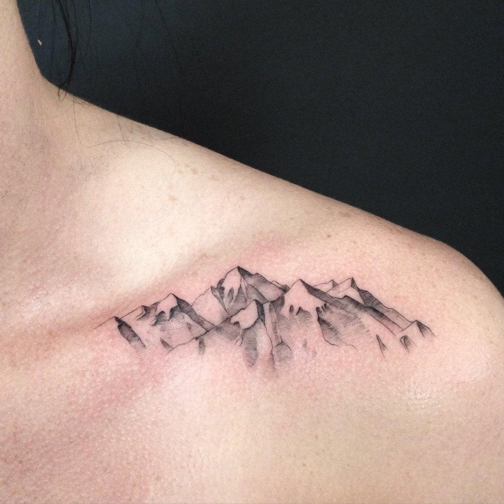 fine line single needle Justin Turkus Philadelphia best tattoo artist moutains clavicle collar.jpg
