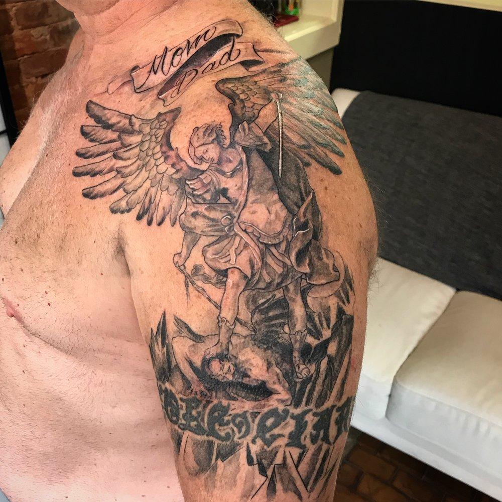bg Justin Turkus Philadelphia fine line lettering best tattoo Artist michael archangel banner wings fullsize.jpg