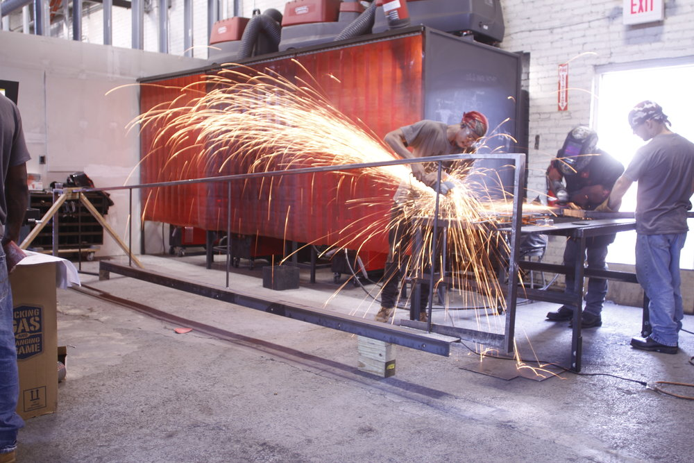 Steel anchor, ramp, and handrail components were prefabricated by the Trade Institute of Pittsburgh's welding apprentices