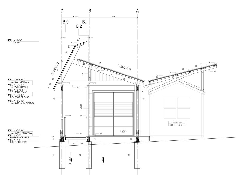 A covered porch connects the sales area with an existing office shed. The butterfly roof collects rainwater in a storage cistern where it is used for watering plants.