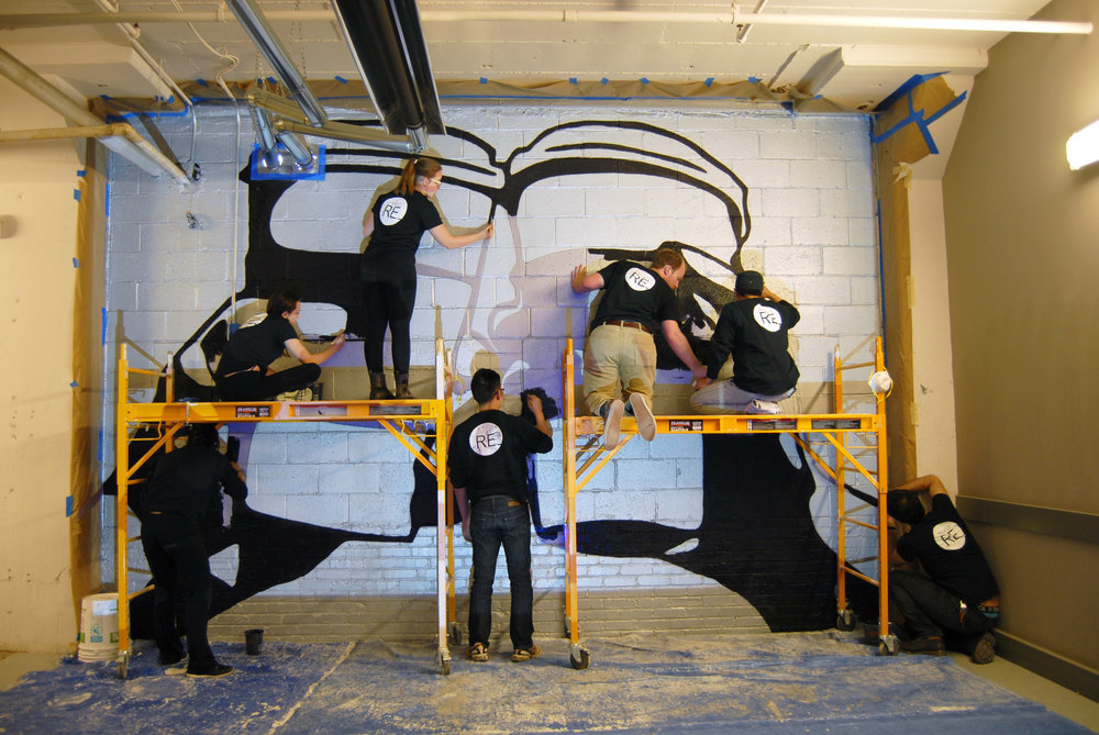 UDBS students paint the large graphic that now resides behind the cafe, emphasizing FIRST COURSE's brand and giving the cafe a heightened presence in the space.
