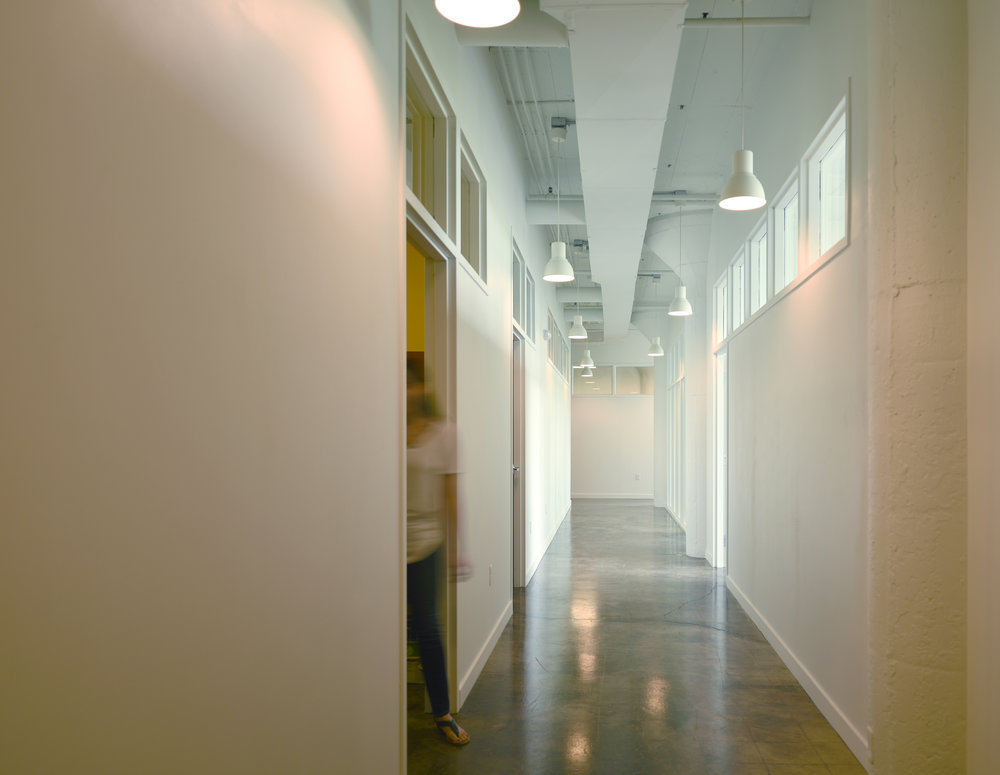 Administrative offices balance light with privacy to facilitate support services for their students, such as counseling and job placement assistance.