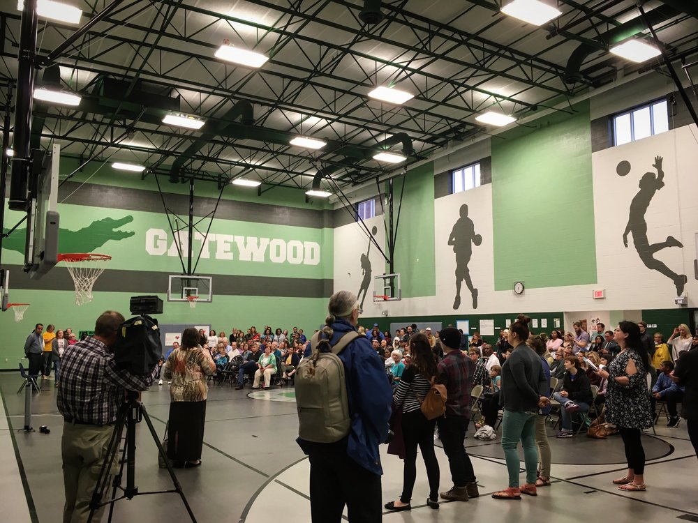 Family, neighbors, business owners, school staff, and students meet to show their disapproval of potentially closing Gatewood Elementary on Tuesday, March 29th, 2017.