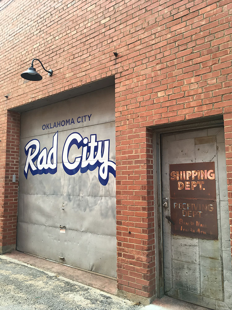 Adam at Rad City needed some signage on his garage door in the alley. They provided the design and I provided the paint. I was super excited to paint along side this amazing old shipping/receiving sign.