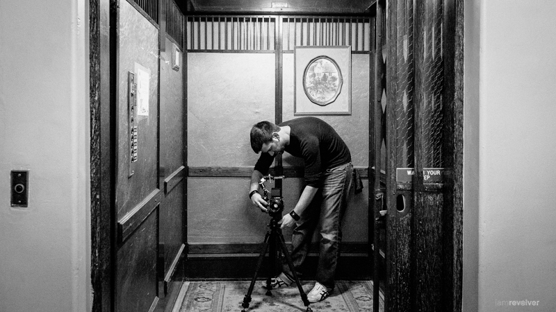 Filming through the waist-level of the Bronica in the 89 year-old manual Otis elevator. Shot by  @natashacolleran