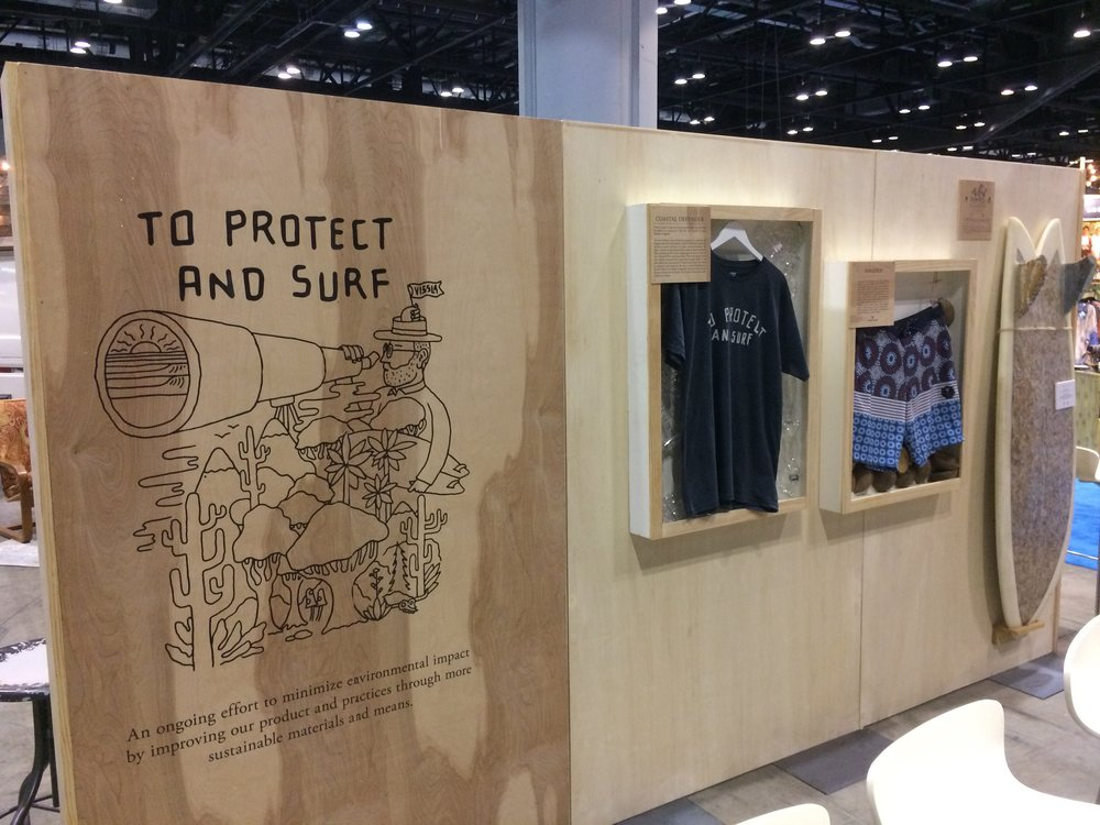 Inside the  Vissla  booth.digging the wall wood vibes here.