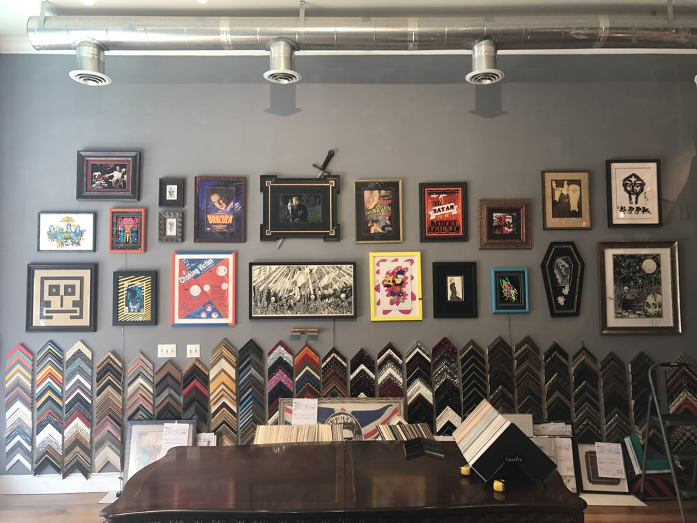 Happening now! All of our framed artworks are marked down to rock bottom prices! Most of these pieces are by local artists, and all of them have been marked down by at least 50%. Sale runs until we run out of pieces! Come by anytime and snag something unique!