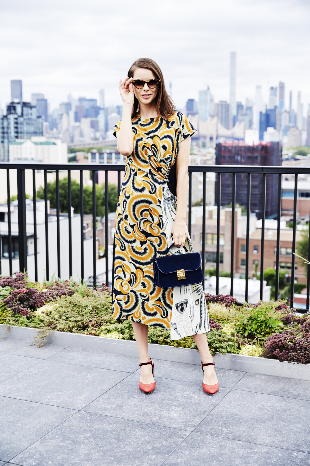 DRIES VAN NOTEN Floral & Fern-Print Dress  /  LOEFFLER RANDALL Leily Velvet Pumps  /  MARK CROSS Dorothy Velvet Shoulder Bag  /  BARTON PERREIRA Kismet Sunglasses  /  AGMES Gia Earrings   I've always been a fan of  Dries Van Noten 's bold prints. They're a great way to make a statement with minimum effort. I'd wear this look to daytime meetings, but it works for drinks with friends, too. It's important to maintain a balance, so with a statement dress like that, make sure your accessories and especially your shoes are emphasizing it, not competing with it. I love the texture and color of these  Loeffler Randall heels .