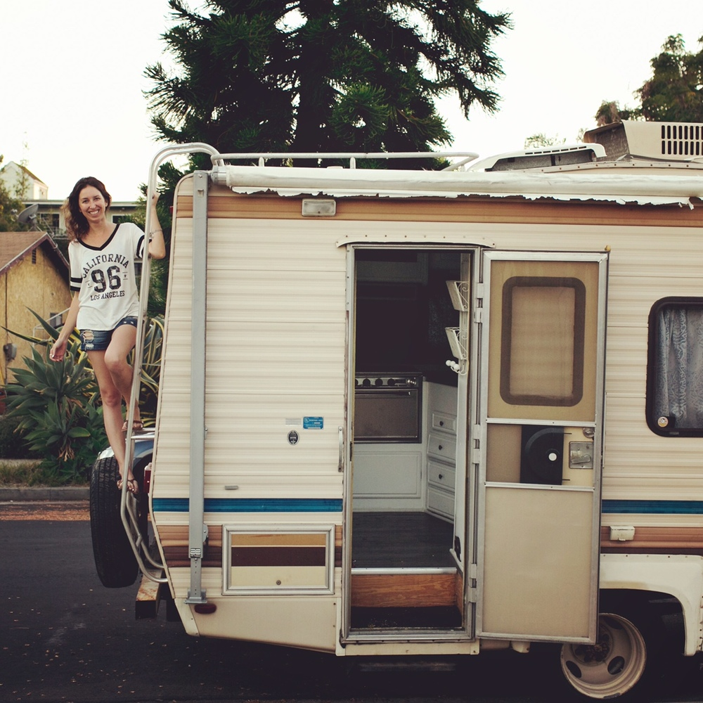 Rachel and her RV—ready for some epic adventures