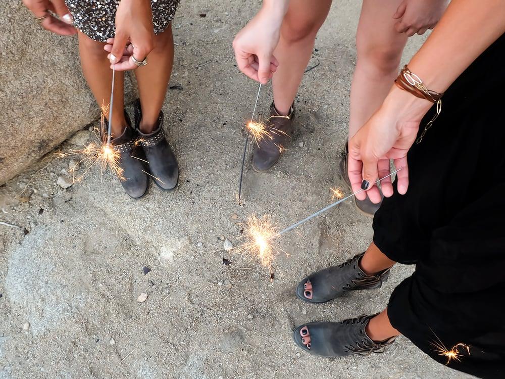 Sparklers! Photo by Rachel Farabaugh. Shoes by Baske California.