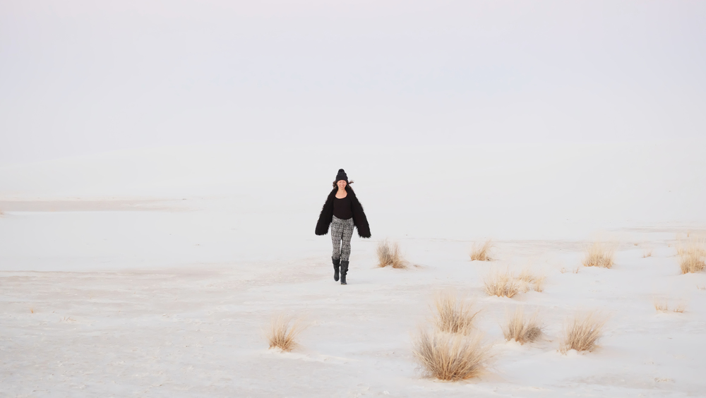 Rachel emerging from a white out sand storm.