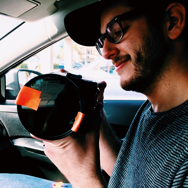 Coolest guy. So thankful for his help on the music video this last weekend, but even more thankful to now call him my friend.     Here he is professionally rigging a filter into the vintage lens of the Digital Bolex we were fortunate to use.    #disneyormusicvideo  (at Sophe's Donuts)