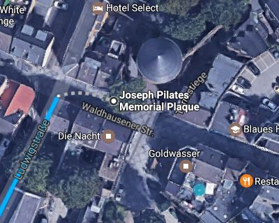 Satellite view of streets and landmarks near joseph pilates plaque. look for the black, cone-shaped building and the plaque will be in front of it.