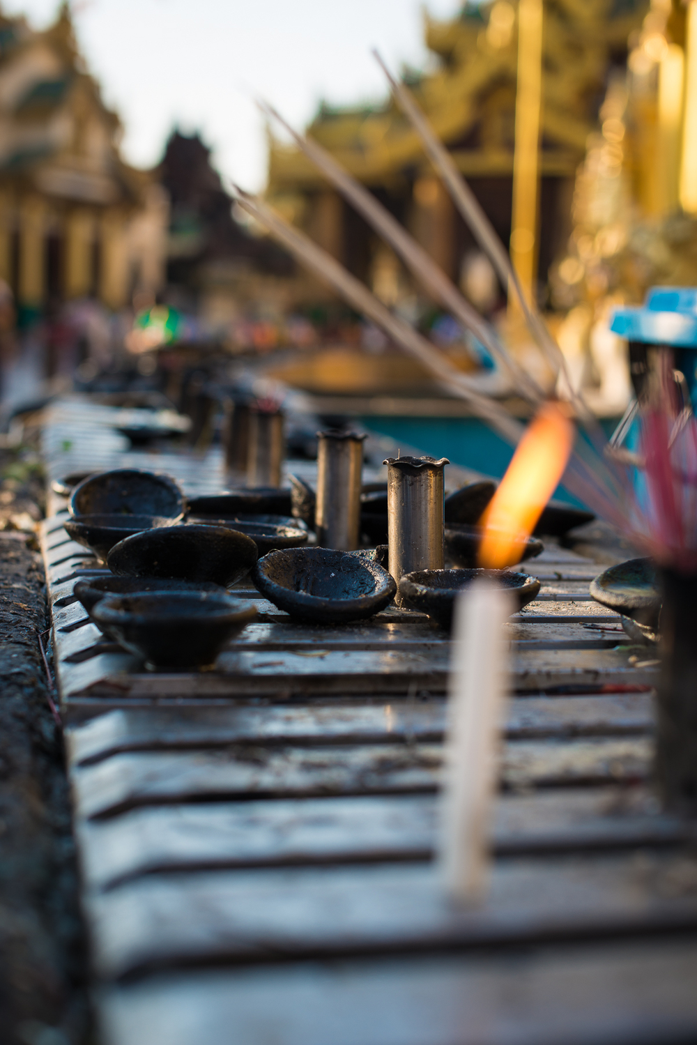 Candles, incense and oil lamps at Shwedagon Pagoda. Yangon, Myanmar