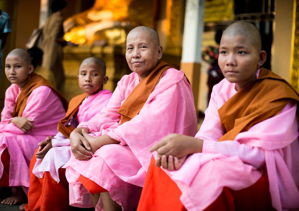 Buddhist nun with novices at Shwedagon Pagoda. Yangon, Myanmar