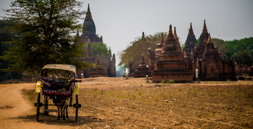 Temples and Horse Drawn Carriage at Bagan. Bagan, Myanmar