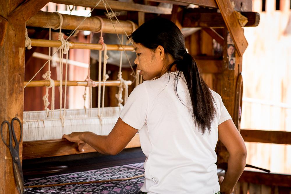 Woman operating a loom. Inle Lake, Myanmar