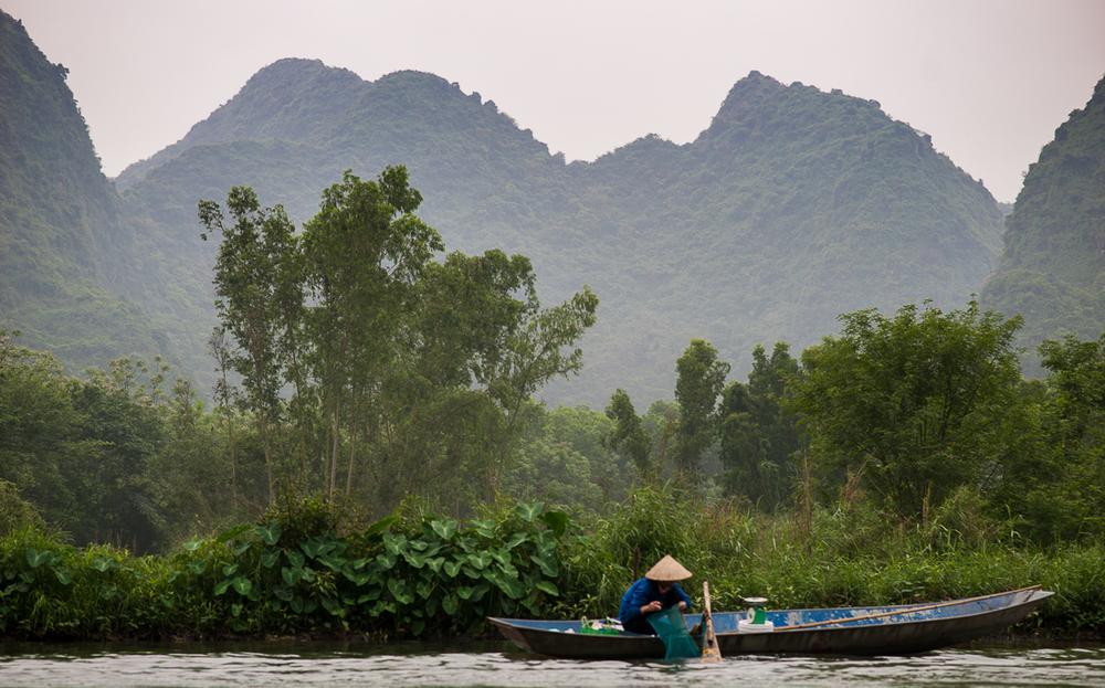 Fisherman on the river on the way to Perfume Pagoda. Hanoi, Vietnam