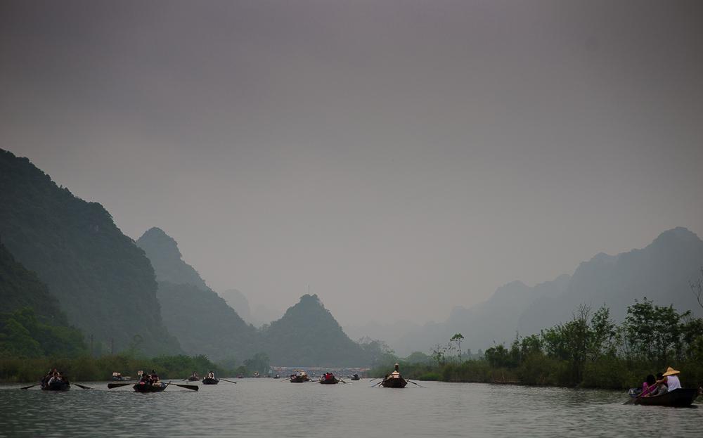 Heading down river to the Perfume Pagoda. Hanoi, Vietnam