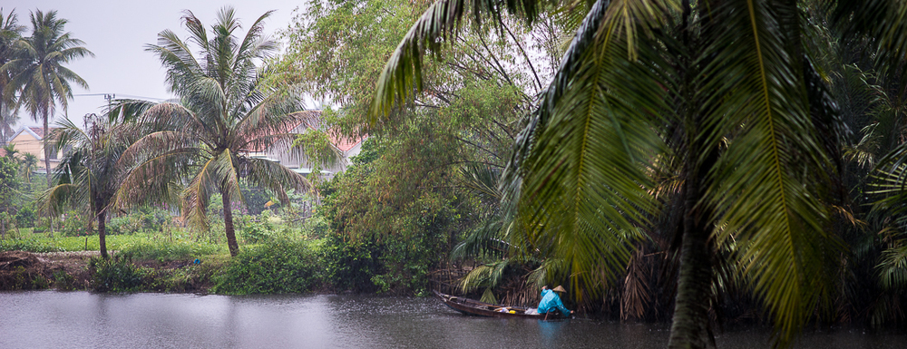 Fishing on the river in the rain. Hoi An, Vietnam