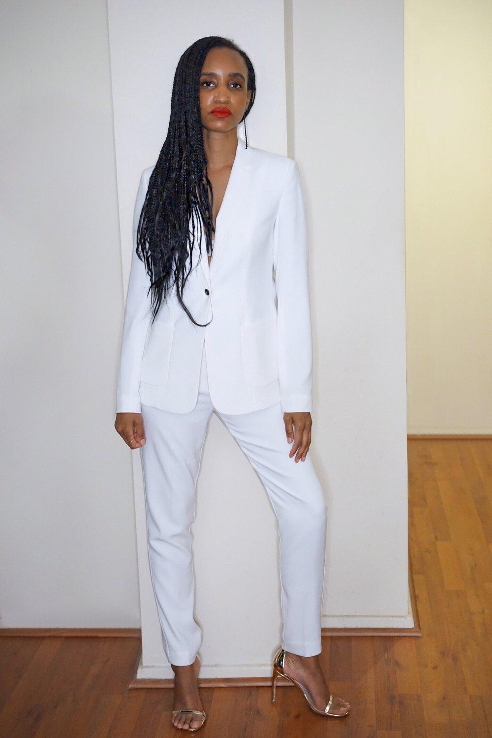 christine_the_style_d_affaire_elie_tahari_white _suit_hm_earring_stuart_weitzman_gold_shoes_chan lug_necklace_fenty_beauty_lipstick_bodysuit_guess_jacquie aiche_rings.jpg